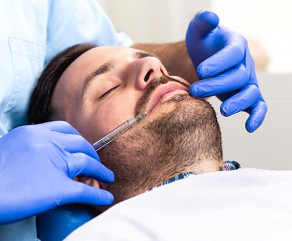 Man resting in dental chair during dental appointment