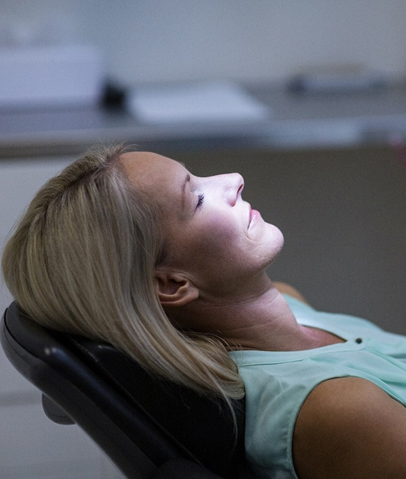 Woman relaxed in dental chair after nitrous oxide sedation in Lincoln, NE