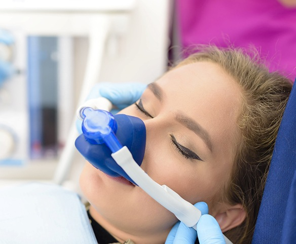 Female patient fitted with nitrous oxide sedation mask