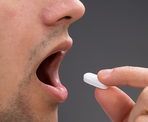 Patient taking oral conscious sedation pill